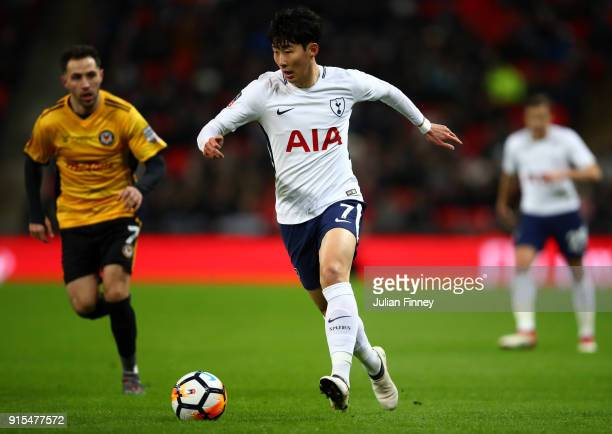 HeungMin Son of Tottenham Hotspur runs with the ball during The Emirates FA Cup Fourth Round Replay match between Tottenham Hotspur and Newport...