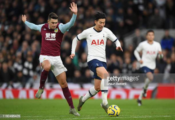 Heung-Min Son of Tottenham Hotspur runs with the ball on his way to scoring his team's third goal during the Premier League match between Tottenham...