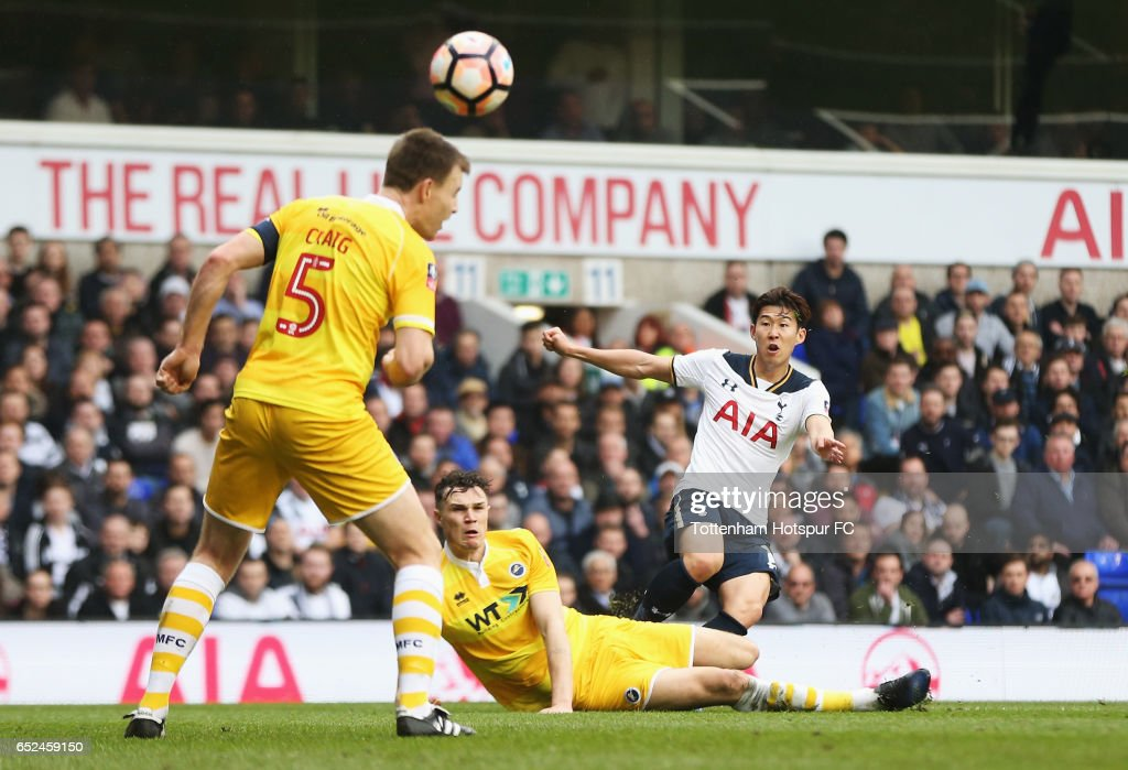 Heung-Min Son of Tottenham Hotspur (R) scores his ides second goal during The Emirates FA Cup Quarter-Final match between Tottenham Hotspur and Millwall at White Hart Lane on March 12, 2017 in London, England.