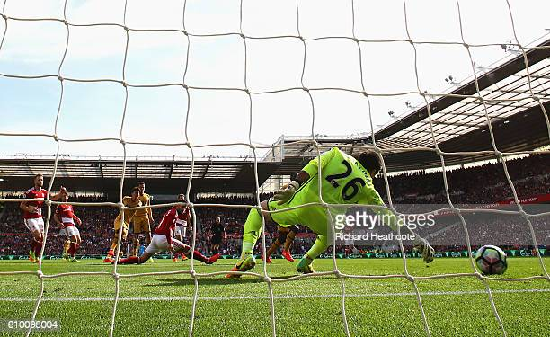 HeungMin Son of Tottenham Hotspur scores his sides first goal during the Premier League match between Middlesbrough and Tottenham Hotspur at the...