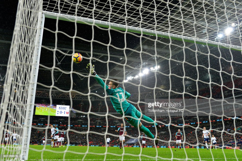 Heung-Min Son of Tottenham Hotspur scores his sides first goal during the Premier League match between Tottenham Hotspur and West Ham United at Wembley Stadium on January 4, 2018 in London, England.