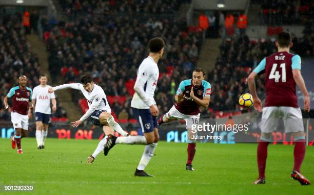 HeungMin Son of Tottenham Hotspur scores his sides first goal during the Premier League match between Tottenham Hotspur and West Ham United at...