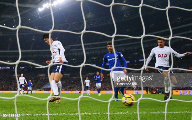 HeungMin Son of Tottenham Hotspur scores his sides first goal during the Premier League match between Tottenham Hotspur and Everton at Wembley...