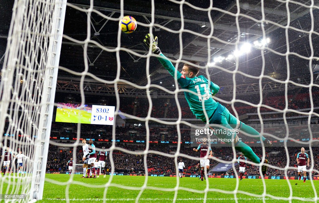 Heung-Min Son (L) of Tottenham Hotspur scores his sides first goal past Adrian of West Ham United during the Premier League match between Tottenham Hotspur and West Ham United at Wembley Stadium on January 4, 2018 in London, England.