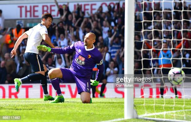 HeungMin Son of Tottenham Hotspur scores his sides fourth goal during the Premier League match between Tottenham Hotspur and Watford at White Hart...