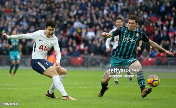 HeungMin Son of Tottenham Hotspur scores his sides fourth goal during the Premier League match between Tottenham Hotspur and Southampton at Wembley...
