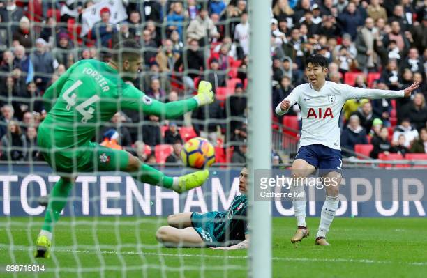 HeungMin Son of Tottenham Hotspur scores his sides fourth goal past Fraser Forster of Southampton during the Premier League match between Tottenham...