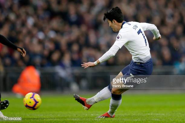 HeungMin Son of Tottenham Hotspur scores his sides second goal during the Premier League match between Tottenham Hotspur and AFC Bournemouth at...