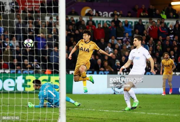 HeungMin Son of Tottenham Hotspur scores his sides second goal during the Premier League match between Swansea City and Tottenham Hotspur at the...
