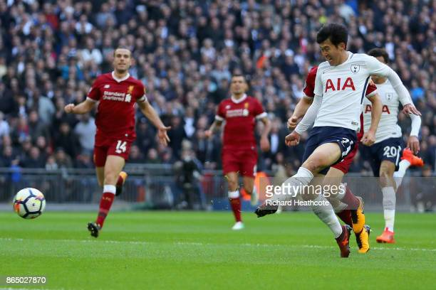HeungMin Son of Tottenham Hotspur scores his sides second goal during the Premier League match between Tottenham Hotspur and Liverpool at Wembley...