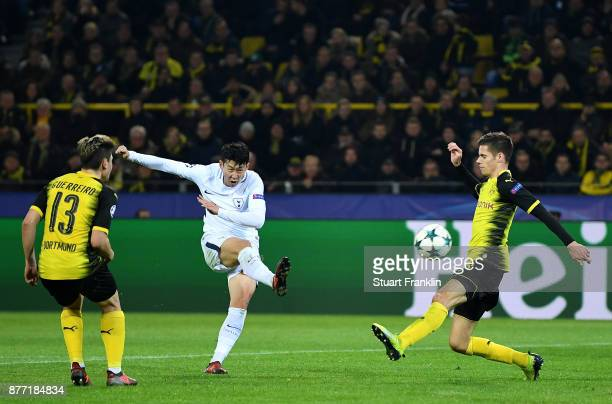 HeungMin Son of Tottenham Hotspur scores his sides second goal during the UEFA Champions League group H match between Borussia Dortmund and Tottenham...