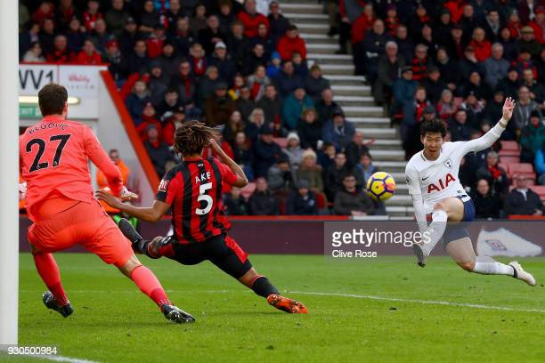 HeungMin Son of Tottenham Hotspur scores his sides second goal during the Premier League match between AFC Bournemouth and Tottenham Hotspur at...