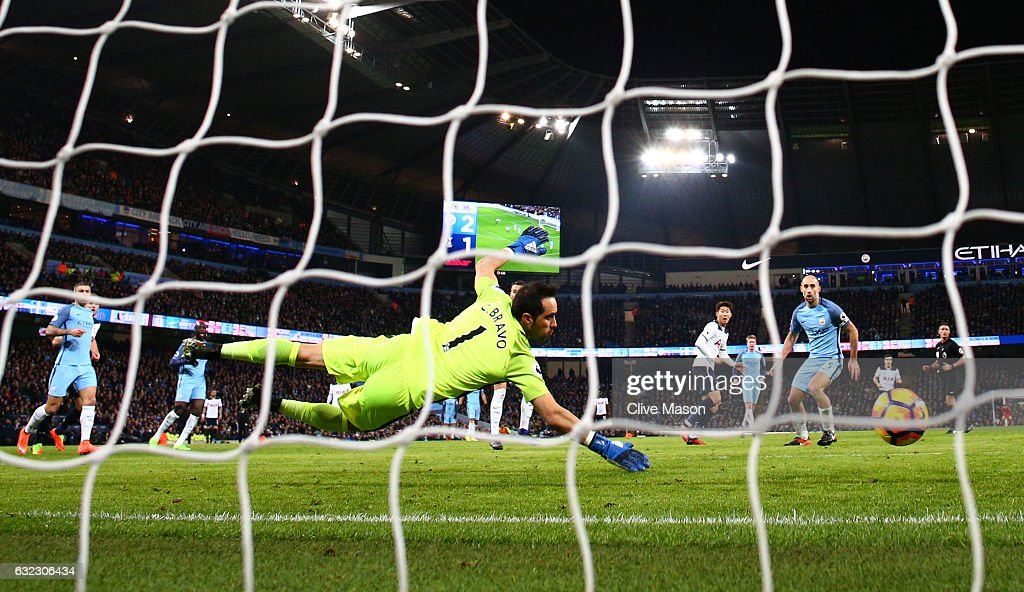 Heung-Min Son of Tottenham Hotspur scores his sides second goal past Claudio Bravo of Manchester City during the Premier League match between Manchester City and Tottenham Hotspur at the Etihad Stadium on January 21, 2017 in Manchester, England.