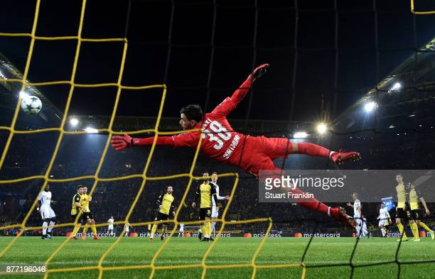 HeungMin Son of Tottenham Hotspur scores his sides second goal past Roman Buerki of Borussia Dortmund during the UEFA Champions League group H match...