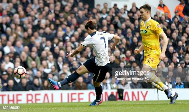 HeungMin Son of Tottenham Hotspur scores his sides third goal during The Emirates FA Cup QuarterFinal match between Tottenham Hotspur and Millwall at...
