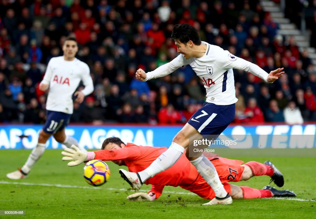Heung-Min Son of Tottenham Hotspur scores his sides third goal past Asmir Begovic of AFC Bournemouth during the Premier League match between AFC Bournemouth and Tottenham Hotspur at Vitality Stadium on March 11, 2018 in Bournemouth, England.