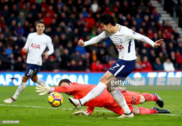 HeungMin Son of Tottenham Hotspur scores his sides third goal past Asmir Begovic of AFC Bournemouth during the Premier League match between AFC...