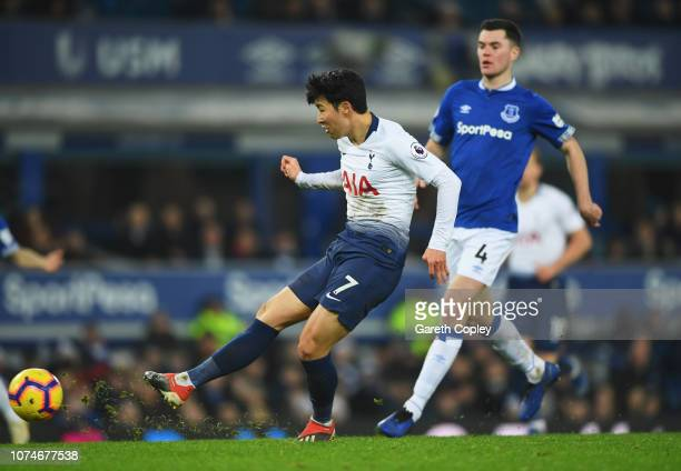 HeungMin Son of Tottenham Hotspur scores his team's fifth goal during the Premier League match between Everton FC and Tottenham Hotspur at Goodison...