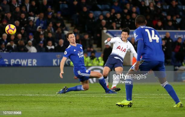 HeungMin Son of Tottenham Hotspur scores his team's first goal as Jonny Evans of Leicester City attempts to block during the Premier League match...