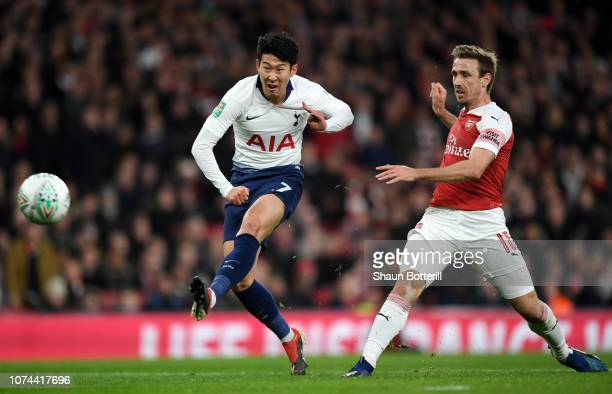 Heung-Min Son of Tottenham Hotspur scores his team's first goal as Nacho Monreal of Arsenal watches during the Carabao Cup Quarter Final match...