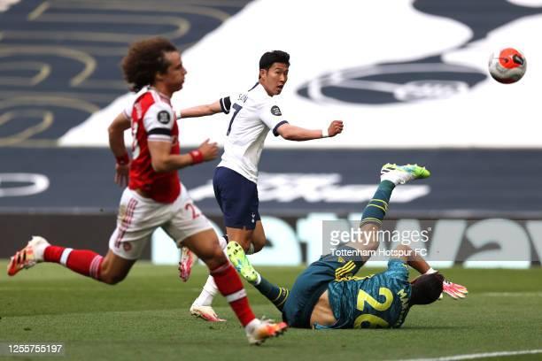 Heung-Min Son of Tottenham Hotspur scores his teams first goal during the Premier League match between Tottenham Hotspur and Arsenal FC at Tottenham...