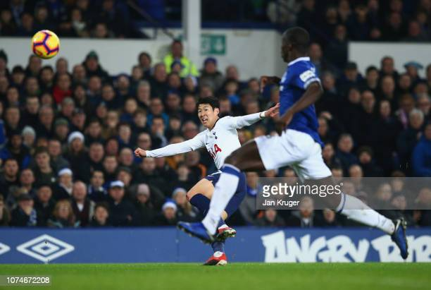HeungMin Son of Tottenham Hotspur scores his team's first goal past Kurt Zouma of Everton during the Premier League match between Everton FC and...