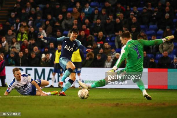 HeungMin Son of Tottenham Hotspur scores his team's fourth goal past Scott Davies of Tranmere Rovers during the FA Cup Third Round match between...