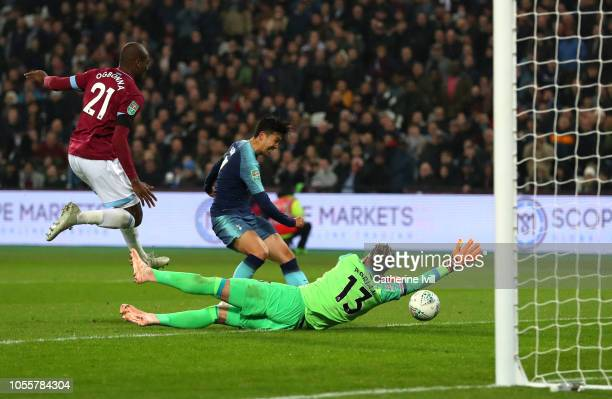 HeungMin Son of Tottenham Hotspur scores his team's second goal during the Carabao Cup Fourth Round match between West Ham United and Tottenham...