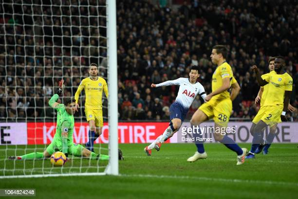 HeungMin Son of Tottenham Hotspur scores his team's third goal during the Premier League match between Tottenham Hotspur and Chelsea FC at Tottenham...
