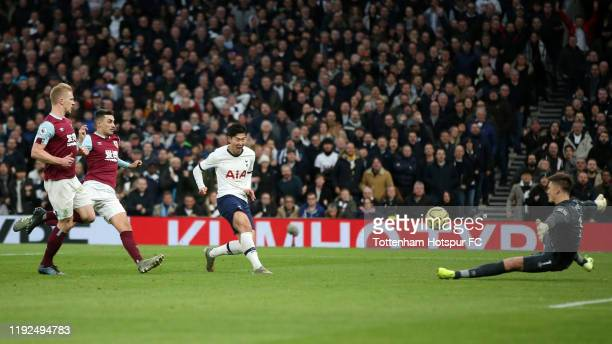 Heung-Min Son of Tottenham Hotspur scores his team's third goal during the Premier League match between Tottenham Hotspur and Burnley FC at Tottenham...