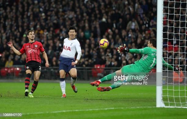 HeungMin Son of Tottenham Hotspur scores his team's third goal past Alex McCarthy of Southampton during the Premier League match between Tottenham...