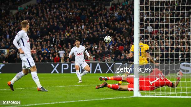 HeungMin Son of Tottenham Hotspur scores the opening goal during the UEFA Champions League Round of 16 Second Leg match between Tottenham Hotspur and...