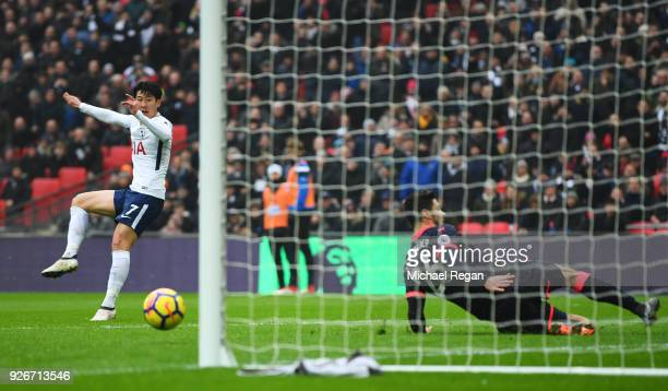 HeungMin Son of Tottenham Hotspur scores their first goal as Christopher Schindler of Huddersfield Town fails to block during the Premier League...