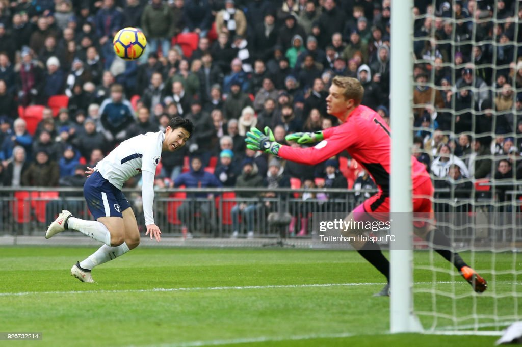 Heung-Min Son of Tottenham Hotspur scores their second goal past Jonas Loessl of Huddersfield Town during the Premier League match between Tottenham Hotspur and Huddersfield Town at Wembley Stadium on March 3, 2018 in London, England.