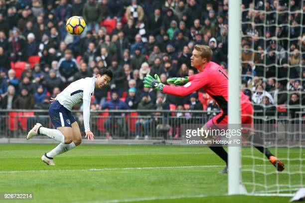 HeungMin Son of Tottenham Hotspur scores their second goal past Jonas Loessl of Huddersfield Town during the Premier League match between Tottenham...