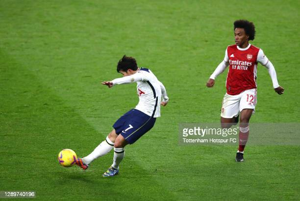 Heung-Min Son of Tottenham Hotspur scores their sides first goal whilst under pressure from Willian of Arsenal during the Premier League match...