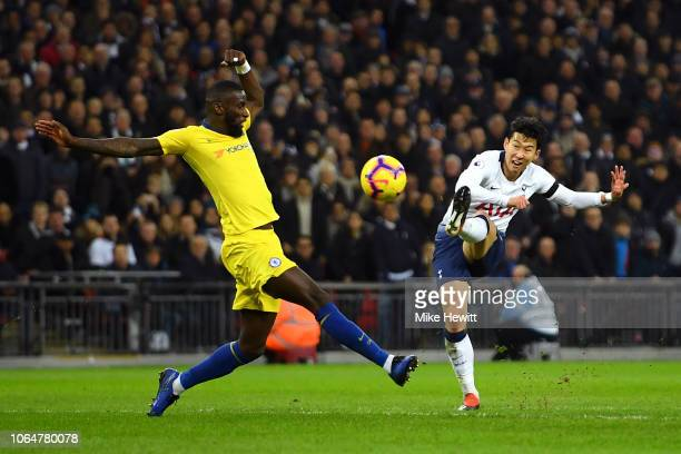 HeungMin Son of Tottenham Hotspur shoots as Antonio Ruediger of Chelsea attempts to block during the Premier League match between Tottenham Hotspur...