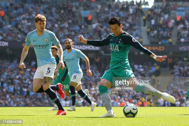 HeungMin Son of Tottenham Hotspur shoots on goal during the Premier League match between Manchester City and Tottenham Hotspur at Etihad Stadium on...