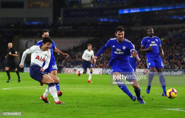 Heung-Min Son of Tottenham Hotspur shoots past Sean Morrison of Cardiff City as he scores his team's third goal during the Premier League match...