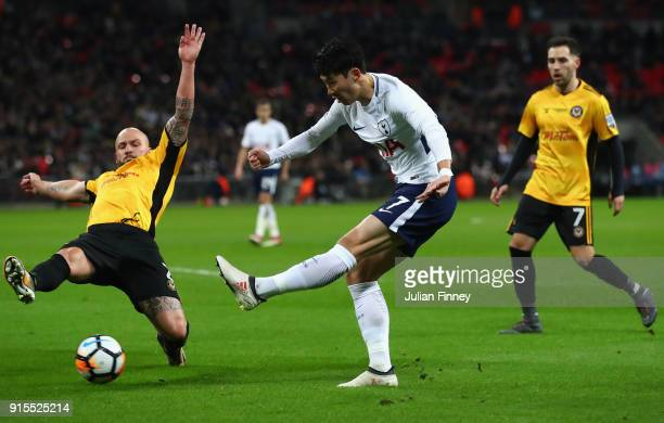 HeungMin Son of Tottenham Hotspur shoots while under pressure from David Pipe of Newport County during The Emirates FA Cup Fourth Round Replay match...