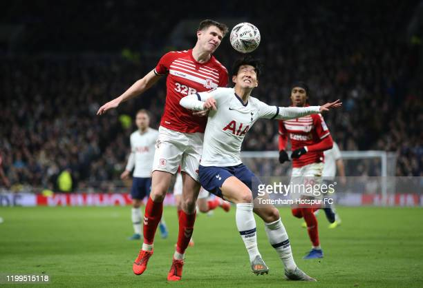 Heung-min Son of Tottenham Hotspur tackles with Tomas Mejias of Middlesbrough during the FA Cup Third Round Replay match between Tottenham Hotspur...