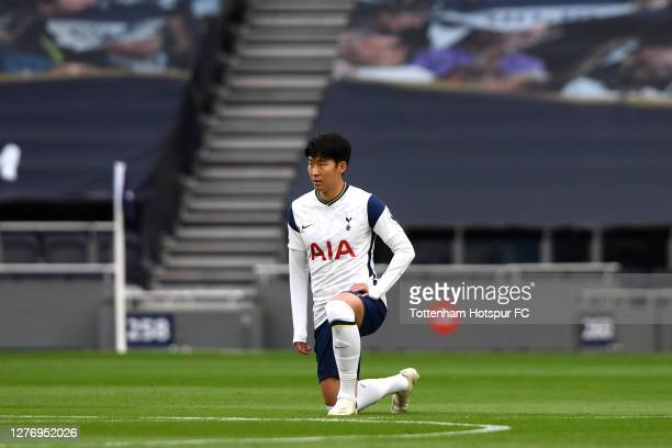 HeungMin Son of Tottenham Hotspur takes a knee in support of the black lives matter movement prior to the Premier League match between Tottenham...