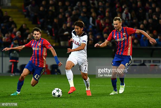 HeungMin Son of Tottenham Hotspur takes on Georgi Schennikov and Aleksey Berezutskiy of CSKA Moscow during the UEFA Champions League Group E match...