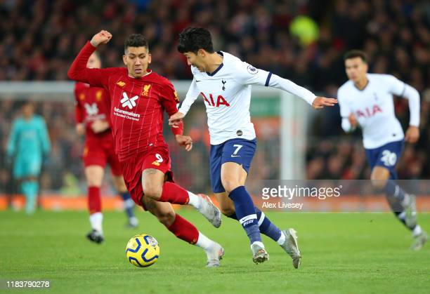 HeungMin Son of Tottenham Hotspur takes on Roberto Firmino of Liverpool during the Premier League match between Liverpool FC and Tottenham Hotspur at...