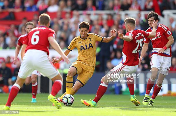 HeungMin Son of Tottenham Hotspur takes on the Middlesbrough defence during the Premier League match between Middlesbrough and Tottenham Hotspur at...