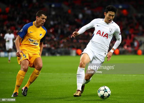 HeungMin Son of Tottenham Hotspur takes the ball away from Jesus Rueda of Apoel FC during the UEFA Champions League group H match between Tottenham...