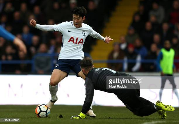 HeungMin Son of Tottenham Hotspur tries to go round Josh Lillis of Rochdale AFC during The Emirates FA Cup Fifth Round match between Rochdale and...