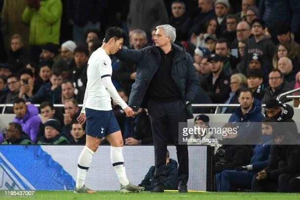HeungMin Son of Tottenham Hotspur walks past Jose Mourinho Manager of Tottenham Hotspur after being shown a red card during the Premier League match...