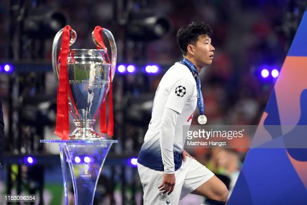 Heung-Min Son of Tottenham Hotspur walks past the Champions League Trophy following the UEFA Champions League Final between Tottenham Hotspur and...