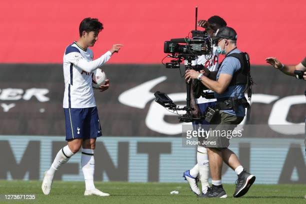 HeungMin Son of Tottenham Hotspur with the match ball after scoring four time in his sides 52 victory during the Premier League match between...